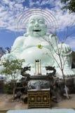Estatua de Buda que se sienta y sonriente Fotografía de archivo