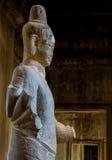 Estatua de Buddha en los vestíbulos de Angkor Wat Fotografía de archivo libre de regalías