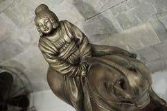 Estatua de cobre amarillo Imagen de archivo libre de regalías