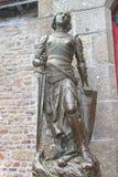 Estatua de Juana de Arco en la abadía del Saint Michel de Mont. Foto de archivo