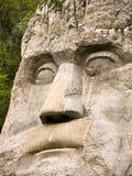 Estatua de la cara de rey Decebal foto de archivo