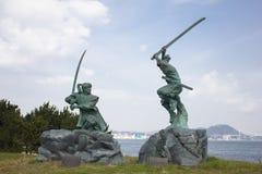 Estatua de Musashi Miyamoto y de Kojiro Sasaki Foto de archivo libre de regalías