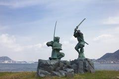 Estatua de Musashi Miyamoto y de Kojiro Sasaki Fotos de archivo libres de regalías