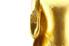 Estatua de oro de Buda de la mano en el fondo blanco Foto de archivo
