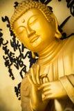 Estatua de oro de Buda Fotos de archivo libres de regalías