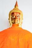 Estatua de oro de Buda en vestido del verano Fotografía de archivo