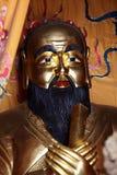 Estatua de oro de Confucio foto de archivo