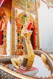 Estatua de oro del Naga Imagen de archivo