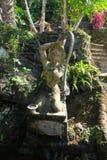 Estatua de piedra agradable en el templo Imagen de archivo libre de regalías