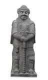 Estatua de piedra asiática antigua del guerrero aislada. Imagen de archivo libre de regalías