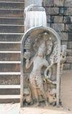 Estatua de piedra de un monje Imagenes de archivo