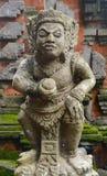Estatua de piedra de una deidad antigua Imagen de archivo libre de regalías