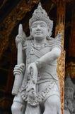 Estatua de piedra de una deidad antigua Foto de archivo