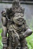 Estatua de piedra de una deidad antigua Imagenes de archivo