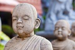 Estatua de piedra del principiantes imagenes de archivo