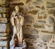 Estatua de piedra del santo patrón de animales Foto de archivo