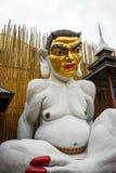Estatua de un demonio que se sienta en café Imagen de archivo