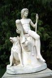 Estatua de un muchacho del pastor y de su perro Foto de archivo