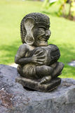 Estatua de un tambor del demonio Foto de archivo