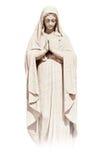 Estatua de una mujer joven religiosa Imagen de archivo libre de regalías