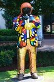 Estatua del hombre que juega el cuerno Foto de archivo