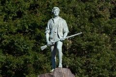 Estatua del Minuteman de la revolución americana Imágenes de archivo libres de regalías