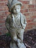 Estatua del niño foto de archivo