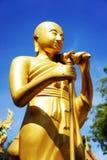 Estatua del oro de un sacerdote Fotografía de archivo libre de regalías