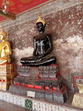 Estatua negra de buddha Fotografía de archivo