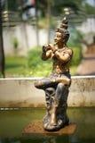 Estatua tailandesa con música del juego Imagen de archivo