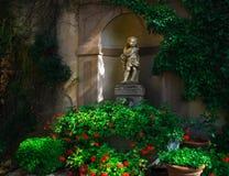 Estatua Toscana del cupido Imágenes de archivo libres de regalías