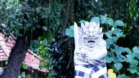 Estatua vestida del Balinese en Ubud - Bali central, Indonesia Fotografía de archivo libre de regalías