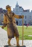 Estatua viva de un hombre, oro vestido Fotos de archivo