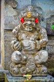 Estatuas antiguas de dios con sonrisa en Bali foto de archivo libre de regalías