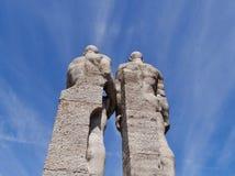 Estatuas de dos atletas de la parte posterior Imagenes de archivo