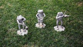 Estatuas musicales de la rana Fotografía de archivo libre de regalías