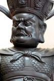 Estatuas negras de la deidad de la religión china. Imagenes de archivo