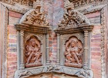 Estatuas talladas en la pared del patio de Mul Chowk, Hanuman Dhoka Royal Palace, cuadrado de Patan Durbar, Lalitpur, Nepal Imagen de archivo libre de regalías