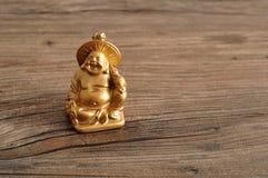 Estatueta de rir a Buda dourada fotografia de stock