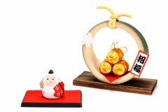 A estatueta do arroz dourado do macaco e da palha três ensaca Imagem de Stock