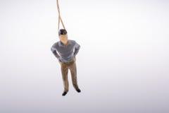 Estatueta do homem amarrada com corda do aa Imagem de Stock Royalty Free