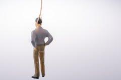 Estatueta do homem amarrada com corda do aa Imagens de Stock Royalty Free