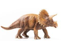 Estatueta plástica do Triceratops no fundo branco imagens de stock