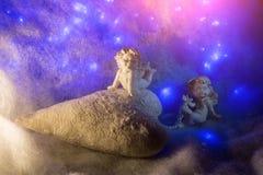 Estatuetas pequenas do anjo Imagens de Stock Royalty Free