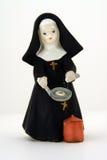 Estatuilla católica de la monja Fotografía de archivo