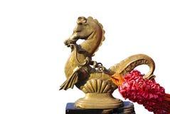 Estatuilla de bronce de un caballo de mar Fotos de archivo libres de regalías