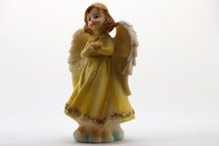Estatuilla del ángel en el fondo blanco Imagenes de archivo