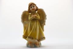 Estatuilla del ángel en el fondo blanco Fotos de archivo
