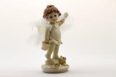 Estatuilla del ángel en el fondo blanco Imágenes de archivo libres de regalías