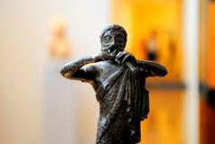 Estatuilla del bronce de la flauta de la cacerola Fotos de archivo